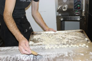 Holger pushes the completed  Gnocchi onto the tray for drying