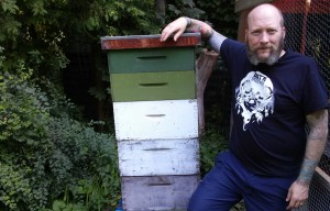 Mark McAlpine with one of the backyard hives.