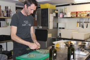Holger preparing rosemary for the focacia.