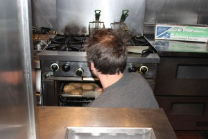 Holger removing potatoes for gnocchi from the oven